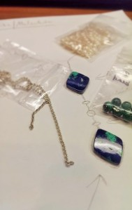 Sample materials, including chain, pearls, and some malachite beads